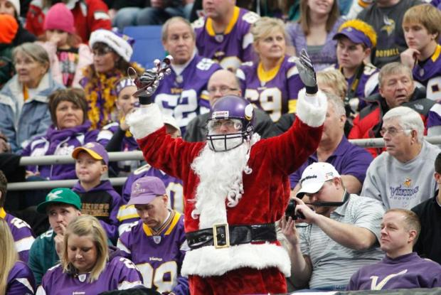 Do the Vikings have the most morose fans ever? The santa is kind creepy, but look at the people around him...